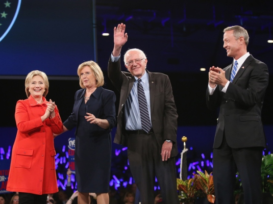 Presidential candidates Hillary Clinton, Bernie Sanders and Martin O'Malley appear with Iowa Democratic Party Chair Andy McGuire (second from left) at Saturday's Jefferson-Jackson Dinner in Des Moines.